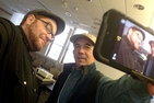 Professors Kyle Brannon (left) and Larry Engel hold a workshop on smartphone filmmaking as part of SOC Week .