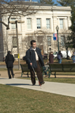 Image of student walking across campus