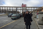 AU student Charlotte Bergmann in front of the Aqueduct of Segovia in Spain.