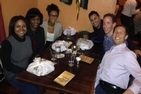 Students enjoy meal with alumni Suzanne Ffolkes, pictured left-center.