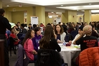 Scores of students at tables attend a portion of the teach-in.