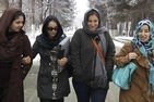 Students featured in the film stroll with Executive Producer Laila Rossi on the campus of Kabul University.  L to R: Arghawan Habibi, Rohila Burhanzoi, Laila Rossi and Nabila Barmaki. Photo by Bill Gentile.
