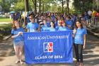 Freshmen from the class of 2014 carry a banner as they begin their walk to convocation.