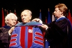 May, 1998: Shimon Peres (center) receives an honorary doctorate from AU. On the left: Howard Wachtel, Center for Israel Studies founding Director. On the right:  Cornelius M. Kerwin, then AU Provost, and current AU President.