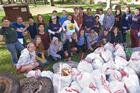 Faculty and students participate in a community clean-up day.