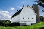 white barn and silo on a farm