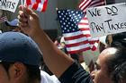 Photo: immigrants carry flags and signs