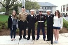James McRedmond joins other students in uniform on campus.