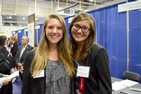 Kayla Ma, CAS/SIS/BA '14, with a current student at the Fall 2014 Job & Internship Fair