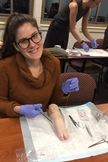 Noy Kaufman learns how to suture on a pig foot.