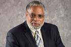 headshot of lonnie bunch in dark suit