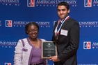 Nazran Baba, CAS/BA '12, receiving the 2013 Carlton Savage Award.