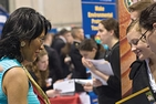 Students and employer meeting at job fair