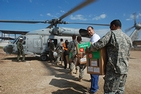 Dr. Malek Sbih unloads vaccines from a helicopter.