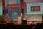 A speaker on the stage at the EDUCAUSE leadership award