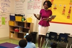 Cheria Funches, SPA/BA '14, leading an elementary school class in New Orleans.