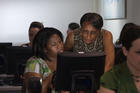 OIT Trainer Assisting a Student
