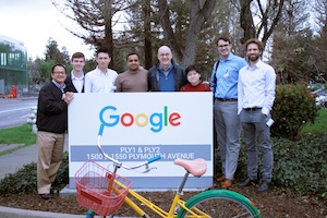 Students stand next to a Google sign.
