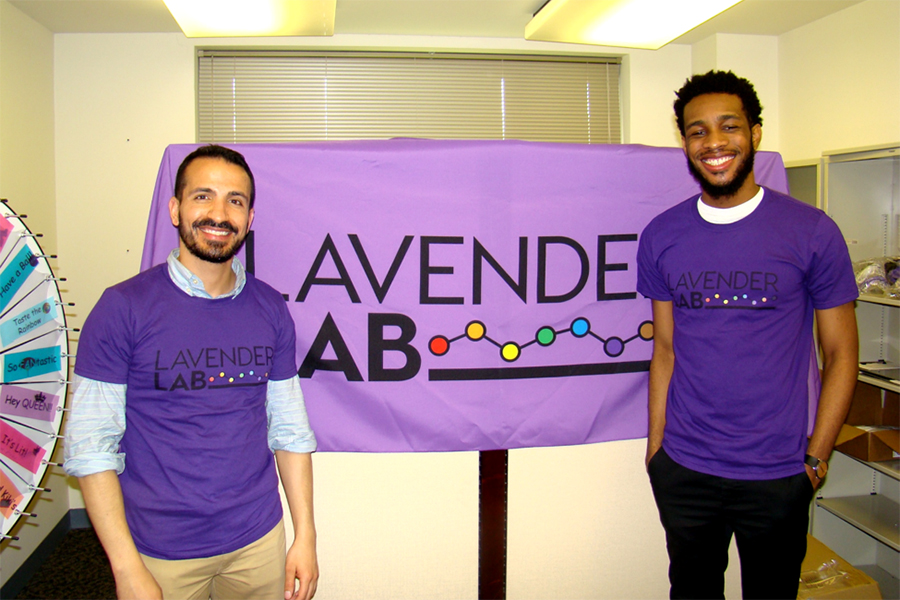 Ethan Mereish and David Hawthorne where purple and stand next to a purple sign that says