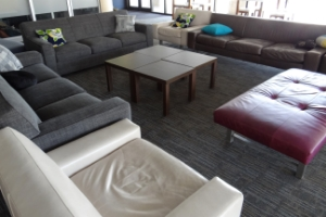 Furnished with sofas and tables, The Perch is used for socializing, studying, and meeting.