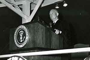 President Dwight Eisenhower at the podium;