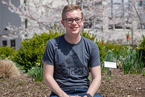 Freshman Harrison Eichelberger standing near the Cherry Blossoms.