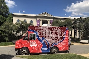 The Humanities Truck in front of Batelle-Tomkins building. There is a map of DC on the truck.