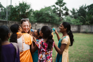 Julie Walton, SIS/MA '19 embraces children's home workers in Sri Lanka.