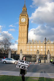 Balimtas stands in front of Big Ben with sign Thank You for Giving Me the World
