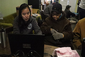 Mia Owens with Ohio resident working at a computer