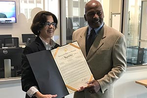 Councilmember Mary Cheh presents resolution to Professor John C. Watson, declaring October 3 as