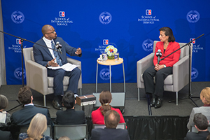 NPR/WAMU radio host Joshua Johnson gestures on a stage with Ambassador Susan Rice, the former National Security Advisor and US ambassador to the UN.