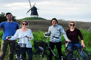 Stephanie Piperno and classmates riding bicycles in Denmark.