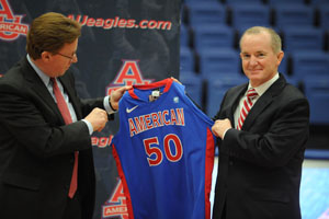 Neil Kerwin and Billy Walker hold an American University jersey