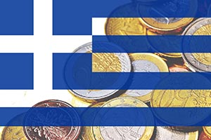 Greek flag atop stack of Euro coins.