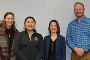From left to right, Jennifer Baron Knowles, Stephanie Tan, Marianne Normaln, Colin Gerker pose for a group picture.