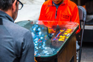 Two young men play pacman at the Game Lab sponsored Indie Arcade event