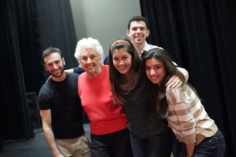 Theatre students embracing Sylvia Greenberg.